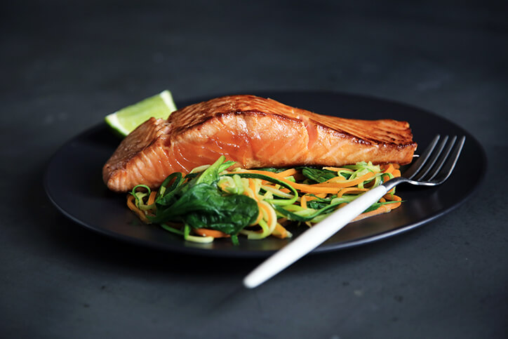 Eating meals like this salmon dinner while following a low-carb diet is unlikely to shorten your lifespan.