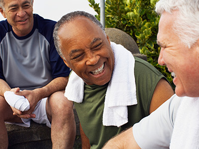 Middle aged men sitting around after a workout