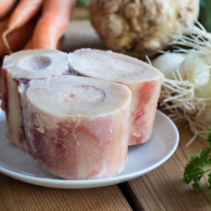 These beef bones and vegetables can be simmered to make a nutritious bone broth that yields a lot of benefits.