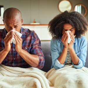 Using natural remedies to prevent or shorten a cold or flu can keep the illness from spreading between families, as it has with this couple.