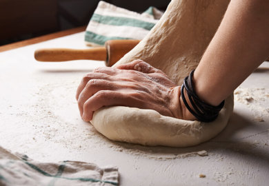 Xanthan gum can add elasticity to gluten-free baked goods, like this dough being kneaded.